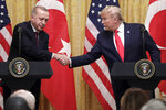 President Donald Trump shakes hands with Turkish President Recep Tayyip Erdogan during a news conference in the East Room of the White House, Wednesday, Nov. 13, 2019, in Washington. (AP Photo/ Evan Vucci)