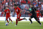 Toronto FC forward Tsubasa Endoh (31) races upfield with Columbus Crew forward Pedro Santos (7) in tow during the first half of an MLS soccer match in Toronto, Sunday, Oct. 6, 2019. (Cole Burston/The Canadian Press via AP)
