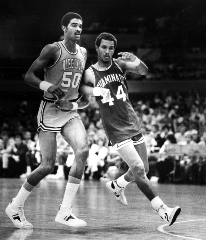 FILE - In this Dec. 23, 1982, file photo, Chaminade's Tony Randolph attempts to edge Virginia's Ralph Sampson, left, out of the play during a college basketball game in Honolulu. Virginia's basketball program, which gave us one of the sport's greatest players in Sampson and its two biggest upsets, by Division II Chaminade and the world's most famous 16 seed in UMBC, is now on the verge of writing a new chapter _ one that would nott be appreciated by nearly as many people were it not for the huge platform Virginia hoops helped create. (AP Photo/File)