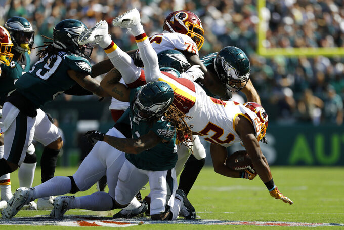 Washington Redskins' Chris Thompson (25) is tackled by Philadelphia Eagles' Ronald Darby (21) during the second half of an NFL football game Sunday, Sept. 8, 2019, in Philadelphia. (AP Photo/Michael Perez)
