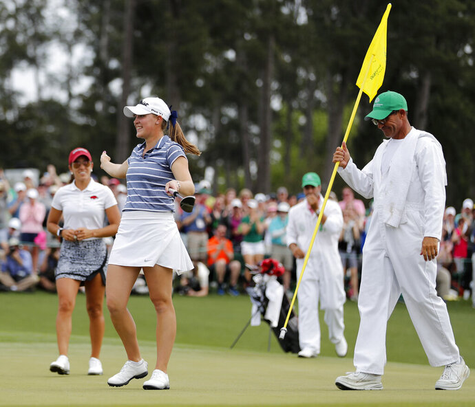 FILE - In this April 6, 2019, file photo, Jennifer Kupcho, second from left, celebrates after sinking a putt on the 18th hole to win the Augusta National Women's Amateur golf tournament in Augusta, Ga. Kupcho advanced to the LPGA Tour finale despite only turning pro five months ago (AP Photo/David Goldman, File)