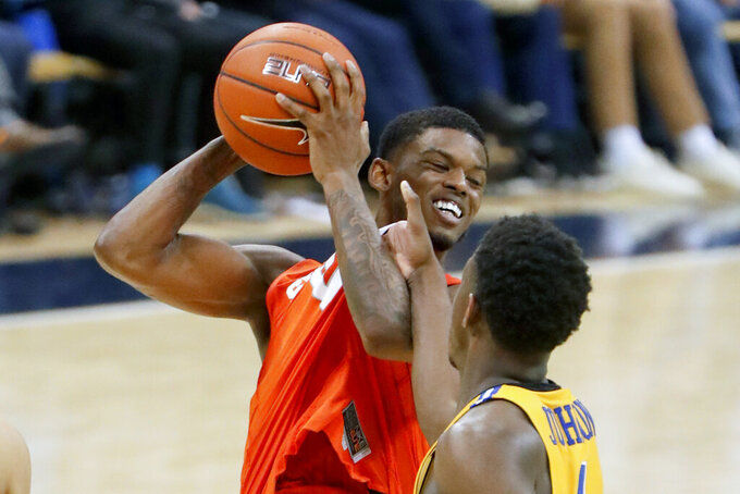 Syracuse's Frank Howard, left, looks to pass as Pittsburgh's Xavier Johnson defends during the second half of an NCAA college basketball game, Saturday, Feb. 2, 2019, in Pittsburgh. Syracuse won 65-56. (AP Photo/Keith Srakocic)