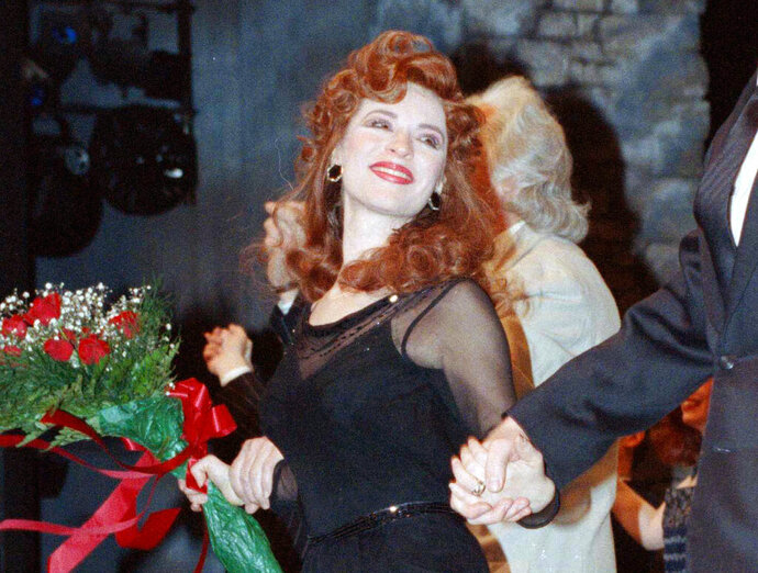 FILE - This April 9, 1990 file photo shows actress Ann Crumb at the curtain call for the Andrew Lloyd Webber musical