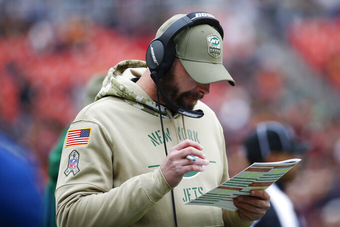 New York Jets head coach Adam Gase on the sidelines in the first half of an NFL football game against the Washington Redskins, Sunday, Nov. 17, 2019, in Landover, Md. (AP Photo/Alex Brandon)
