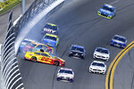 Joey Logano (22), Kyle Busch (18) and Brad Keselowski (2) collide in Turn 4 during the NASCAR Daytona Clash auto race at Daytona International Speedway, Sunday, Feb. 9, 2020, in Daytona Beach, Fla. (AP Photo/Phelan M. Ebenhack)