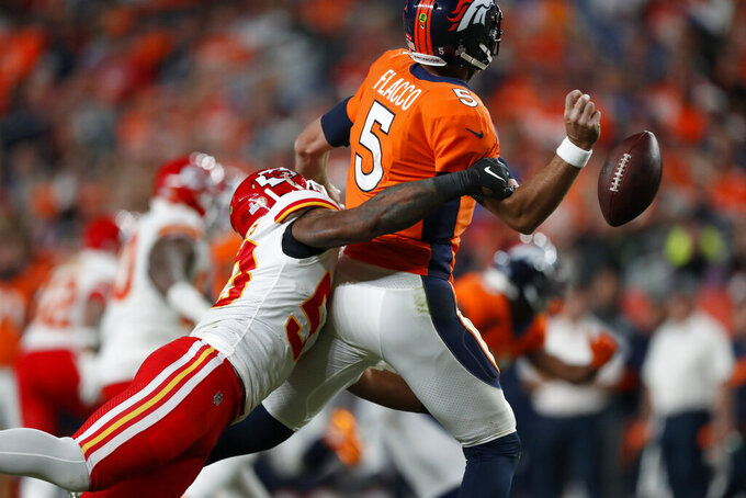 Denver Broncos quarterback Joe Flacco (5) fumbles as he is sacked by Kansas City Chiefs inside linebacker Anthony Hitchens (53) during the first half of an NFL football game, Thursday, Oct. 17, 2019, in Denver. Kansas City recovered the ball for a touchdown. (AP Photo/David Zalubowski)