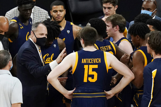 California head coach Mark Fox speaks with his players at a timeout during the first half of an NCAA college basketball game against Colorado in the quarterfinal round of the Pac-12 men's tournament Thursday, March 11, 2021, in Las Vegas. (AP Photo/John Locher)