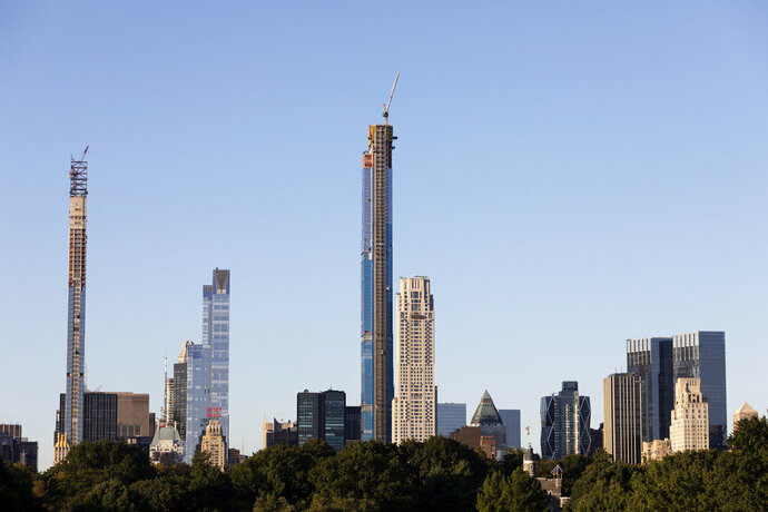 The Central Park Tower, center, is under construction, Tuesday, Sept. 17, 2019 in New York. At 1550 feet (472 meters) the tower is the world's tallest residential apartment building, according to the developer, Extell Development Co. (AP Photo/Mark Lennihan)