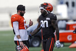 Cleveland Browns quarterback Baker Mayfield, left, talks with wide receiver Jarvis Landry during practice at the NFL football team's training camp facility, Thursday, Aug. 27, 2020, in Berea, Ohio. (AP Photo/Tony Dejak)