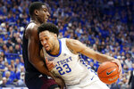 Kentucky's EJ Montgomery, right, collides with Mississippi State's Reggie Perry during the first half of an NCAA college basketball game in Lexington, Ky., Tuesday, Feb. 4, 2020. (AP Photo/James Crisp)