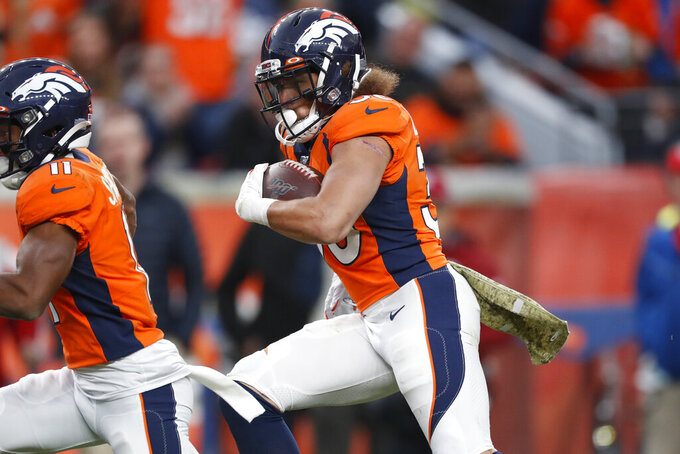 Denver Broncos running back Phillip Lindsay (30) runs for a 30-yard touchdown against the Cleveland Browns during the second half of NFL football game, Sunday, Nov. 3, 2019, in Denver. (AP Photo/David Zalubowski)