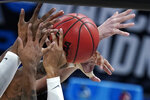 Players from West Virginia and Syracuse battle for a rebound during the first half of a second-round game in the NCAA men's college basketball tournament at Bankers Life Fieldhouse, Sunday, March 21, 2021, in Indianapolis. (AP Photo/Darron Cummings)