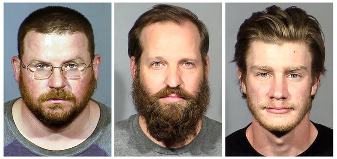 FILE - These undated file booking photo provided by the Las Vegas Metropolitan Police Department show, from left, William L. Loomis, Stephen Parshall and Andrew T. Lynam Jr., three men accused of planning a terror attack during recent Las Vegas protests.  A federal magistrate judge decided Wednesday, June 10, 2020, that Stephen Parshall, 35, and William Loomis, 40, both of Las Vegas, should remain in federal custody, and gave attorneys for Andrew Lynam, until next Tuesday, June 16, 2020, to prepare arguments for his release pending trial. (Las Vegas Metropolitan Police Department via AP, File)