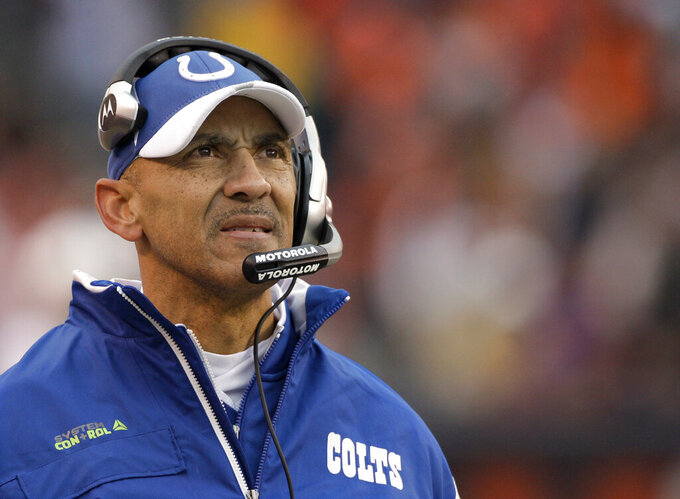 FILE - In this Nov. 30, 2008, file photo, Indianapolis Colts coach Tony Dungy watches from the sideline as his team plays the Cleveland Browns during the third quarter of an NFL football game in Cleveland. Dungy won a Super Bowl with the Colts after the 2006 season. Four of Dungy's former defensive assistants went on to get head coaching jobs: Mike Tomlin, Herm Edwards, Lovie Smith and Leslie Frazier. His former offensive coordinator in Indianapolis, Jim Caldwell, also got head coaching opportunities with the Colts and Detroit. (AP Photo/Amy Sancetta, File)