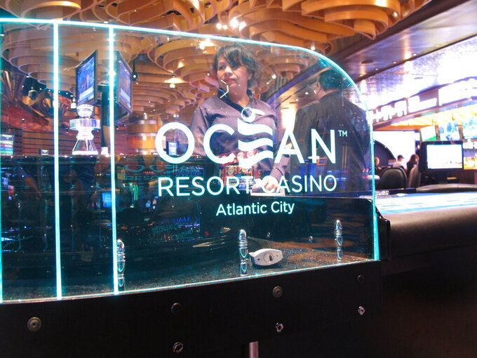 FILE - In this June 20, 2019, file photo, a roulette dealer waits for bets to be placed at the Ocean Casino Resort in Atlantic City, N.J. On April 6, 2021, Luxor Capital, the New York hedge fund that owns the casino, told The Associated Press it is selling an ownership interest of up to 50% in the casino to the Ilitch family of Detroit, which owns professional sports teams, the Little Caesars pizza chain, and a Detroit casino. (AP Photo/Wayne Parry, File)