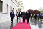 U.S. Secretary of State Antony Blinken, center right, walks with Afghanistan's Foreign Minister Mohammad Haneef Atmar, center left, at the presidential palace in Kabul, Afghanistan, Thursday, April 51, 2021. Blinken made an unannounced visit to Afghanistan on Thursday to sell Afghan leaders and a wary public on President Joe Biden's decision to withdraw all American troops from the country and end America's longest-running war. (Presidential Palace via AP)