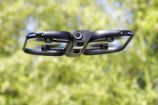 This June 22, 2018, photo shows a Skydio R1 drone in Redwood City, Calif. Skateboarders, surfers and YouTube stars used to be the target customers for California drone startup Skydio, which builds sophisticated self-flying machines that can follow people around and capture their best moves on video. Now it's police officers and soldiers getting equipped with the pricey drones. U.S. political and security concerns about the world's dominant consumer drone-maker, China-based DJI, have opened the door for Skydio and other companies to pitch their drones for government and business customers. (AP Photo/Jeff Chiu)