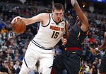 Denver Nuggets center Nikola Jokic, left, bumps against Cleveland Cavaliers center Tristan Thompson during the first half of an NBA basketball game Saturday, Jan. 11, 2020, in Denver. (AP Photo/David Zalubowski)