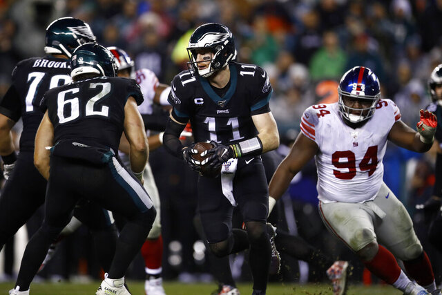 Philadelphia Eagles' Carson Wentz plays during the first half of an NFL football game against the New York Giants, Monday, Dec. 9, 2019, in Philadelphia. (AP Photo/Matt Rourke)