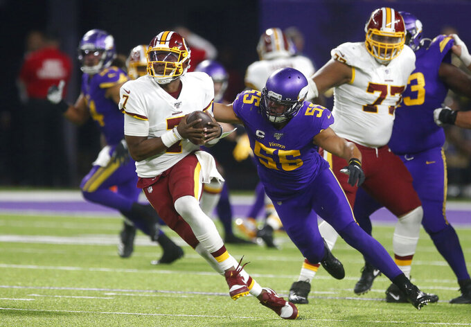 FILE  - In this Oct. 24, 2019, file photo, Washington Redskins quarterback Dwayne Haskins (7) is sacked by Minnesota Vikings outside linebacker Anthony Barr (55) during the second half of an NFL football game in Minneapolis. Barr was coach Mike Zimmer's first draft pick, taken ninth overall in 2014. (AP Photo/Jim Mone)