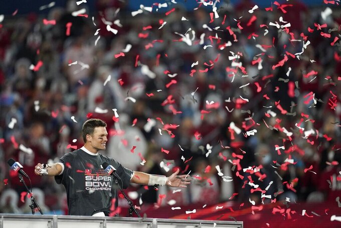 Tampa Bay Buccaneers quarterback Tom Brady celebrates after defeating the Kansas City Chiefs in the NFL Super Bowl 55 football game Sunday, Feb. 7, 2021, in Tampa, Fla. The Buccaneers defeated the Chiefs 31-9 to win the Super Bowl. (AP Photo/Ashley Landis)