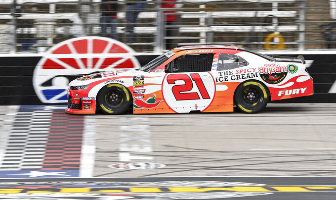 Driver Kaz Grala races down the front stretch during qualifying for a NASCAR auto race at Texas Motor Speedway, Saturday, March 30, 2019, in Fort Worth, Texas. (AP Photo/Larry Papke)