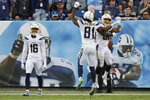 Los Angeles Chargers running back Austin Ekeler, right, celebrates with Mike Williams (81) after Ekeler scored a touchdown against the Tennessee Titans on a 41-yard pass play in the fourth quarter of an NFL football game Sunday, Oct. 20, 2019, in Nashville, Tenn. (AP Photo/James Kenney)