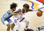 Stanford guard Daejon Davis (1) controls the ball next to North Carolina guard Caleb Love (2) during the first half of an NCAA college basketball game in the semifinals of the Maui Invitational, Tuesday, Dec. 1, 2020, in Asheville, N.C.  (AP Photo/Kathy Kmonicek)