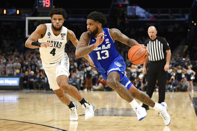 Seton Hall guard Myles Powell (13) drives to the basket past Georgetown guard Jagan Mosely (4) during the first half of an NCAA college basketball game, Wednesday, Feb. 5, 2020, in Washington. (AP Photo/Nick Wass)
