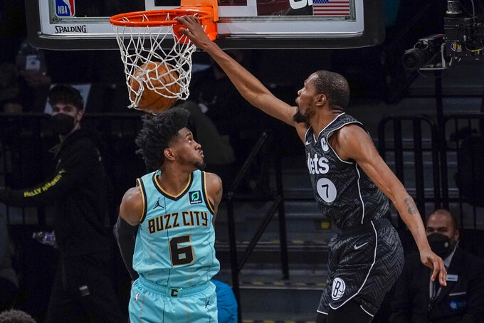 Brooklyn Nets forward Kevin Durant (7) goes to the basket past Charlotte Hornets forward Jalen McDaniels (6) during the second half of an NBA basketball game Friday, April 16, 2021, in New York. (AP Photo/Mary Altaffer)