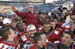 FILE - In this Jan. 1, 2010, file photo, Florida State head coach Bobby Bowden is carried on the shoulders of his players after their 33-21 win over West Virginia in the Gator Bowl NCAA college football game in Jacksonville, Fla. Bowden, the folksy Hall of Fame coach who built Florida State into an unprecedented college football dynasty, has died. He was 91. Bobby's son, Terry, confirmed to The Associated Press that his father died at home in Tallahassee, Fla., surrounded by family early Sunday, Aug. 8, 2021. (Bob Self/The Florida Times-Union via AP, File)