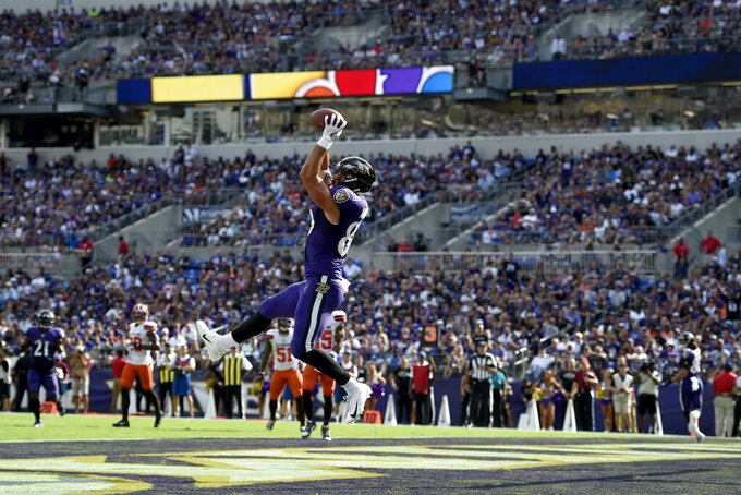 Baltimore Ravens tight end Mark Andrews catches a touchdown pass from quarterback Lamar Jackson during the second half of an NFL football game against the Cleveland Browns Sunday, Sept. 29, 2019, in Baltimore. (AP Photo/Gail Burton)