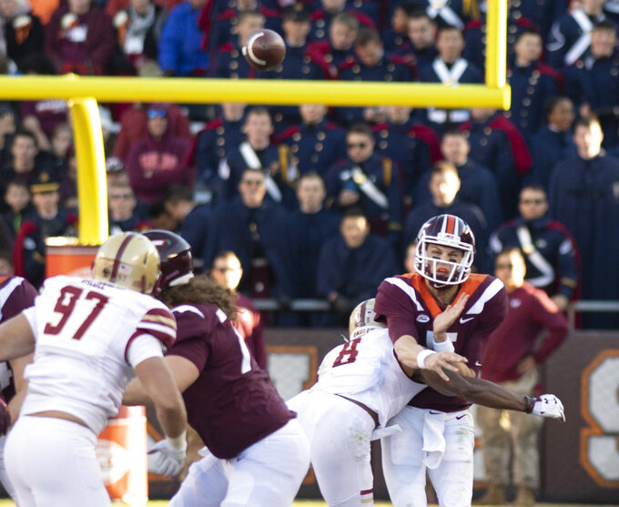 Virginia Tech quarterback Ryan Willis goes down on injury after a hit from Boston College strong safety Will Harris  during the first half of an NCAA college football game in Blacksburg, Va., Saturday, Nov. 3, 2018. (AP Photo/Matt Bell)