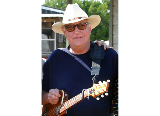 "FILE - This Oct. 30, 2005 file photo shows Country singer Jerry Jeff Walker at a campaign fundraiser at Willie Nelson's ranch outside Austin, Texas.  The Texas country singer and songwriter who wrote the pop song ""Mr. Bojangles,"