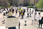 FILE - In this April 9, 2020 file photo, about 75 people wearing masks and carrying signs protest outside the Ohio Statehouse on Thursday, April 9, 2020, in Columbus, Ohio.  A plot to kidnap Michigan's governor has put a focus on the security of governors who have faced protests and threats over their handling of the coronavirus pandemic. The threats have come from people who oppose business closures and restrictions on social gatherings. (AP Photo/Andrew Welsh-Huggins)
