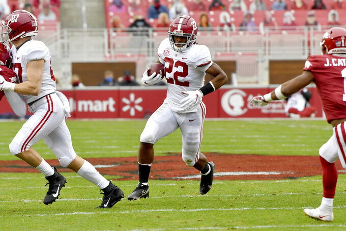 Alabama running back Najee Harris (22) runs the ball against Arkansas during the first half of an NCAA college football game Saturday, Dec. 12, 2020, in Fayetteville, Ark. (AP Photo/Michael Woods)