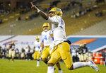 UCLA quarterback Dorian Thompson-Robinson celebrates after his long run for a touchdown in the second half of an NCAA college football game against Colorado, Saturday, Nov. 7, 2020, in Boulder, Colo. (AP Photo/David Zalubowski)