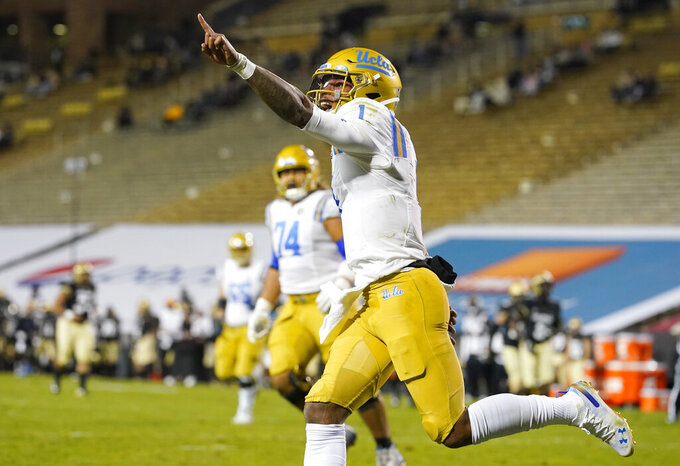 UCLA quarterback Dorian Thompson-Robinson celebrates after his long run for a touchdown in the second half of an NCAA college football game against Colorado, Saturday, Nov. 7, 2020, in Boulder, Colo. (AP Photo/David Zalubowski)