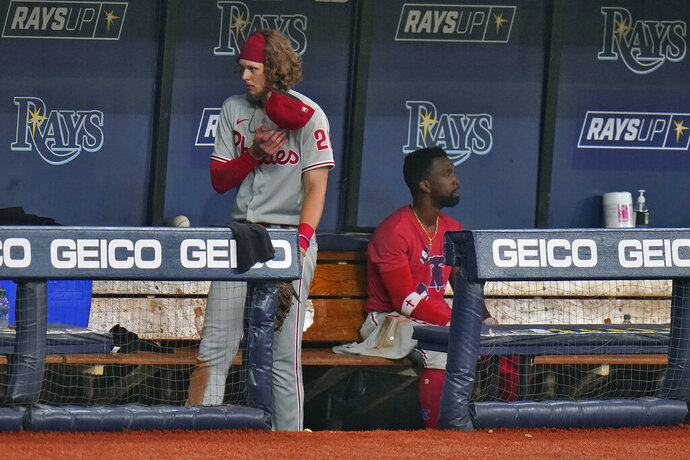 Philadelphia Phillies' Alec Bohm, left, and Andrew McCutchen remain in the dugout after the team lost to the Tampa Bay Rays during a baseball game Saturday, Sept. 26, 2020, in St. Petersburg, Fla. (AP Photo/Chris O'Meara)