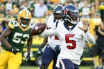 Houston Texans' Tyrod Taylor drops back during the first half of a preseason NFL football game against the Green Bay Packers Saturday, Aug. 14, 2021, in Green Bay, Wis. (AP Photo/Mike Roemer)