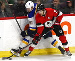 FILE - In this March 14, 2019, file photo, Ottawa Senators right wing Bobby Ryan (9) drives the puck along the boards with St. Louis Blues center Tyler Bozak (21) during second-period NHL hockey game action in Ottawa, Ontario. Ryan has been named the Bill Masterton Trophy winner for publicly sharing his battle with alcohol issues. The 33-year-old Ryan missed more than two months after entering the NHL/NHLPA players assistance program on Nov. 20, 2019. (Justin Tang/The Canadian Press via AP, File)