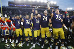 Members of the Notre Dame football team sing at the end of an NCAA college football game against Virginia Tech, Saturday, Nov. 2, 2019, in South Bend, Ind. Notre Dame won 21-20. (AP Photo/Carlos Osorio)