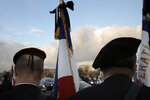 French veterans stand before a ceremony held on the Alexandre III bridge in central Paris, Thursday Jan.7, 2021 to pay homage to two soldiers killed in Mali by an improvised explosive device that hit their armored vehicle on Saturday. Three other French soldiers died just five days earlier in similar circumstances. (AP Photo/Christophe Ena)