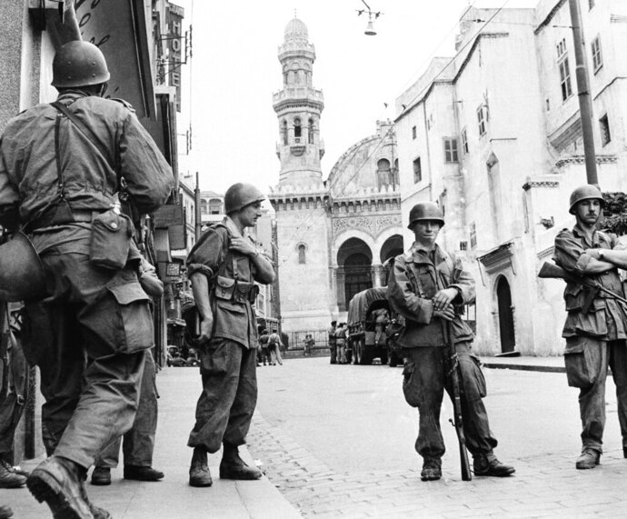 FILE - In this May 27, 1956 file photo, French troops seal off Algiers' notorious casbah, 400-year-old teeming Arab quarter. French President Emmanuel Macron wants to take further steps to reckon with France's colonial-era wrongs in Algeria but is not considering an official apology, his office said. (AP Photo, file)