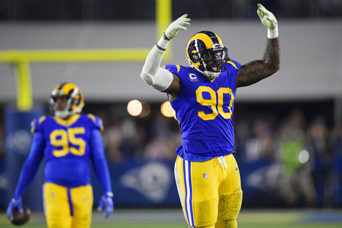 Los Angeles Rams defensive end Michael Brockers celebrates during the second half in an NFL divisional football playoff game against the Dallas Cowboys Saturday, Jan. 12, 2019, in Los Angeles. (AP Photo/Mark J. Terrill)