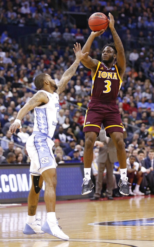 Iona's Asante Gist (3) shoots over North Carolina's Seventh Woods (0) in the first half during a first round men's college basketball game in the NCAA Tournament in Columbus, Ohio, Friday, March 22, 2019. (AP Photo/Paul Vernon)