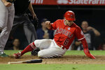 Los Angeles Angels' David Fletcher scores on a sacrifice fly by Albert Pujols during the fifth inning of a baseball game against the Oakland Athletics in Anaheim, Calif., Tuesday, Sept. 24, 2019. (AP Photo/Alex Gallardo)