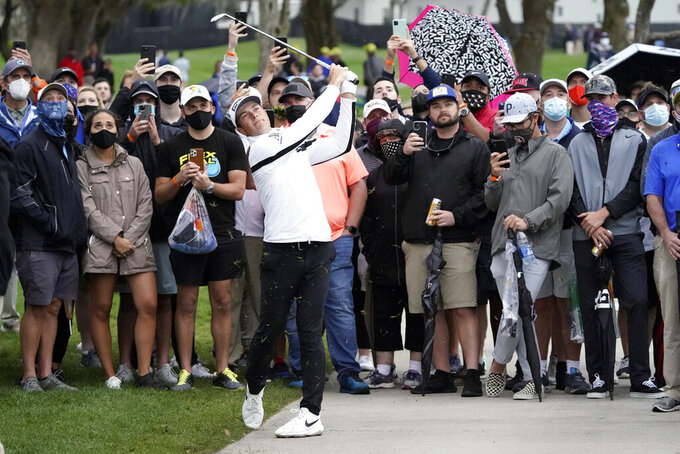 Viktor Hovland, of Norway, hits a shot from the cart path off the 16th fairway during the third round of the Arnold Palmer Invitational golf tournament Saturday, March 6, 2021, in Orlando, Fla. (AP Photo/John Raoux)