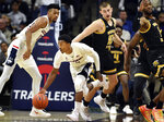 Connecticut's Alterique Gilbert (3) steals the ball during the first half of the team's NCAA college basketball game against Wichita State on Saturday, Jan. 26, 2019, in Storrs, Conn. Wichita State's Erik Stevenson (10) and others watch. (AP Photo/Stephen Dunn)