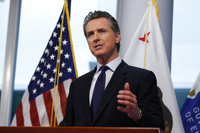 FILE - In this March 30, 2020, file photo, Gov. Gavin Newsom updates the state's response to the coronavirus, at the Governor's Office of Emergency Services in Rancho Cordova, Calif. Fearing an out-of-control coronavirus outbreak would overwhelm California's health care system,  Newsom declared a statewide emergency on March 4. Within a week dozens of nursing schools pleaded with the state regulators to immediately allow thousands of their students to more quickly complete their education and get to work.  (AP Photo/Rich Pedroncelli, Pool, File)